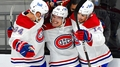 Hráči Canadiens se radují po gólu Suzukiho (uprostřed)
